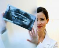 woman with x ray behind screen